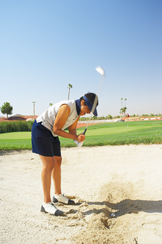 Frustrated golfer in sand trap