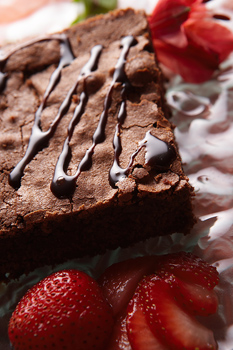 Chocolate brownie with strawberries