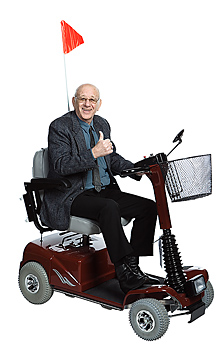 Man riding in motorized scooter