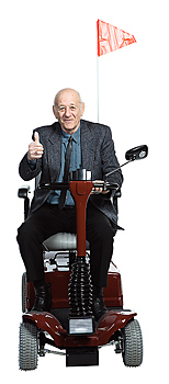 Man in motorized scooter with thumbs-up