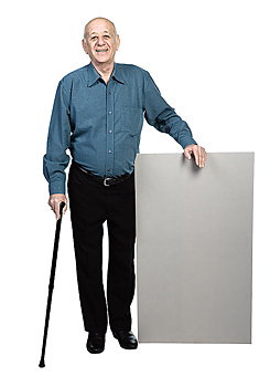 Man standing with cane and blank sign