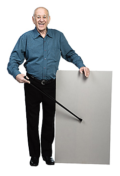 Man pointing to blank sign with cane