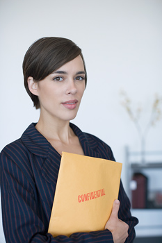 Portrait of businesswoman with confidential document