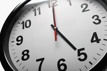 Quitting time on wall clock