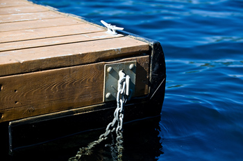 End of dock in water with cleat and chain