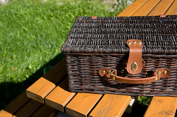 Picnic basket on table outdoors