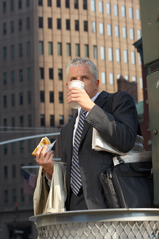 Businessman on the go with coffee and snack