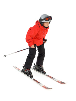 Boy posing as a snow skier