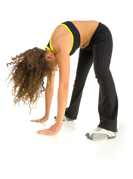 Woman bending over and stretching