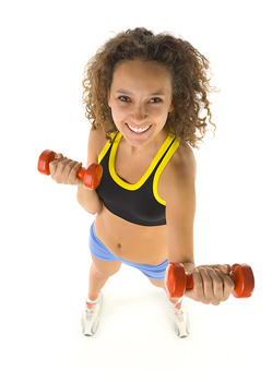 Woman doing aerobics with weights
