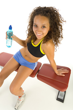 Woman relaxing with water bottle after workout
