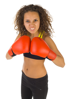 Woman boxer posing with mean facial expression