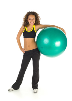 Woman posing with exercise ball