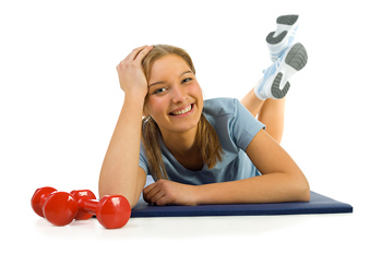 Smiling woman posing on exercise mat