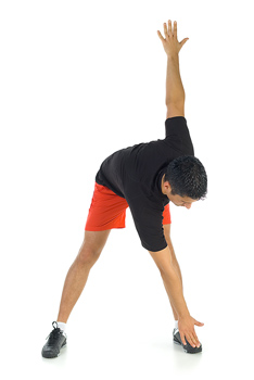 Man bending over and stretching