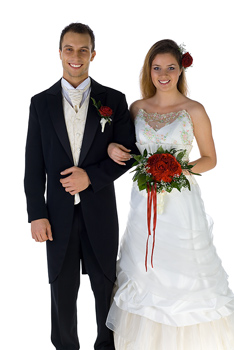 Wedding couple standing arm in arm