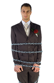 Portrait of chained wedding groom