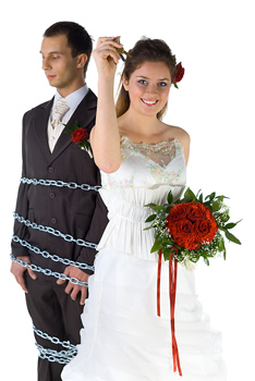 Wedding bride posing by chained groom