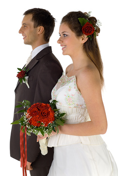 Wedding couple standing side by side