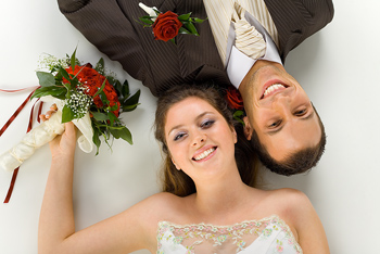 High angle view of wedding couple lying together