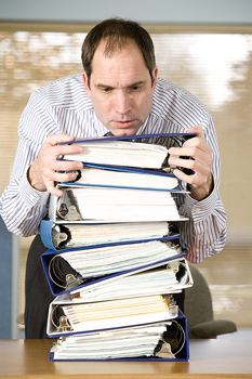 Office worker stacking notebooks