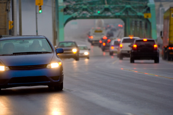 Cars driving in evening rain