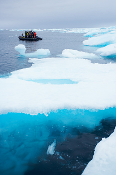 Tourists on raft viewing drift ice in the Arctic
