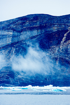 Majestic Arctic cliff along coast with drift ice