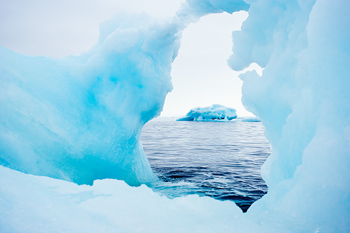 Iceberg viewed through hole in another