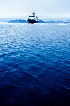 Approaching cruise ship with drift ice on Arctic Ocean