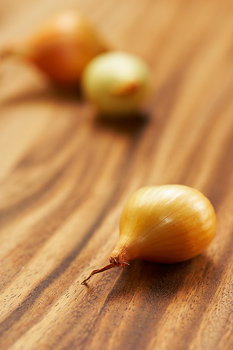 Baby onions on countertop