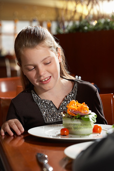 Girl with exotic dish in restaurant