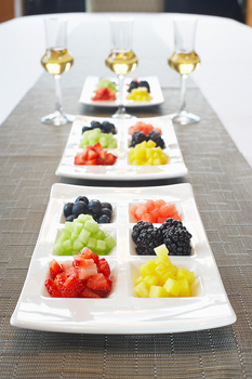 Plates with chunks of diced fresh fruit