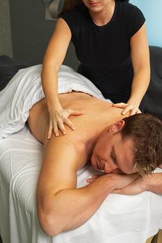 Man receiving massage from woman