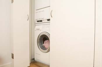 Washer and dryer stacked in closet