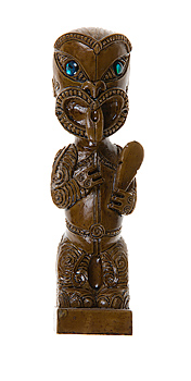Carved wooden idol in human likeness