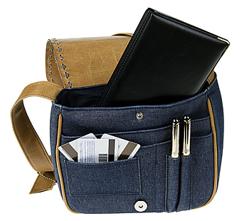 Open leather and denim purse with contents