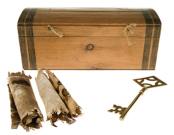 Replica of pirate chest with key and scrolls