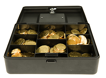 Coins in compartments of open cashbox