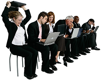 Businesspeople in a row with laptop computers