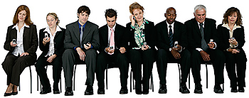 Businesspeople with cell phones text messaging