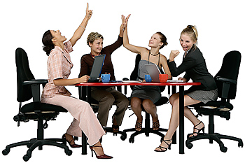 Businesswomen in meeting cheering and doing high five