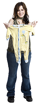 Pregnant woman holding jumpsuit for baby
