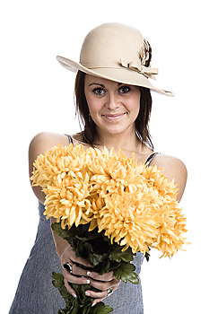 Woman posing with bouquet of flowers