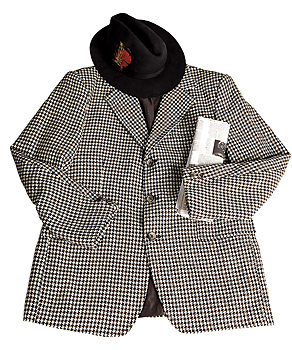 Suit jacket, hat, and newspaper