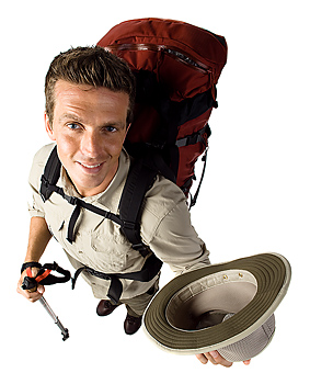 High angle view of hiker doffing hat