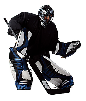 Ice hockey goalie in action pose