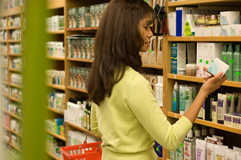 Woman selecting product in health foods store
