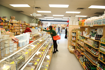 Shopper in aisle of health foods store