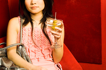 Woman sitting in cocktail lounge